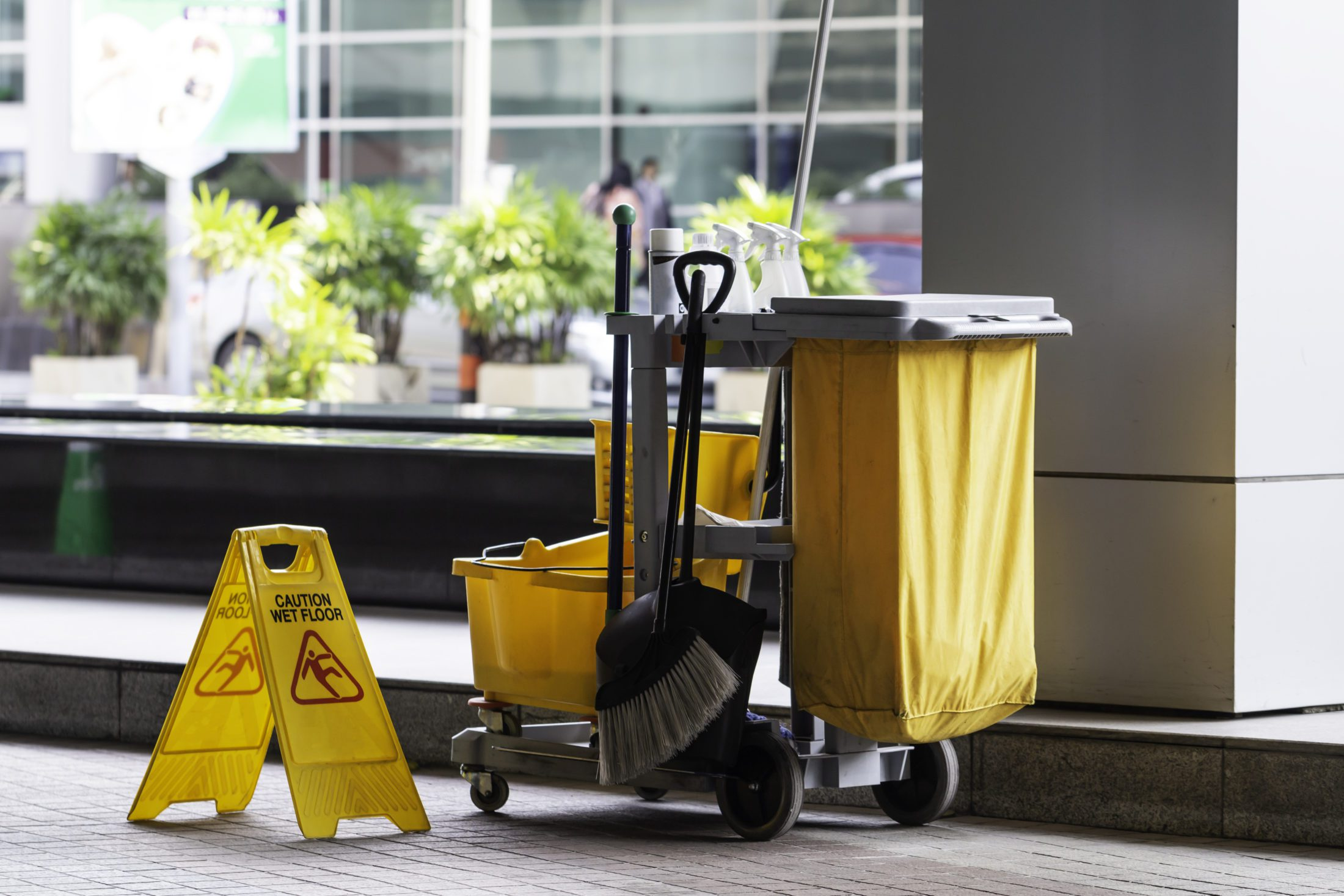Janitorial and mop bucket on cleaning in process.